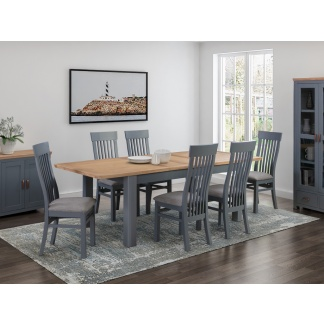 Solid Oak Extendable Dining Table finished in luxurious midnight blue colour with matching chairs.