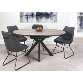 Manhattan Round Extending Dining Table with Chairs at Teds Interiors Newry