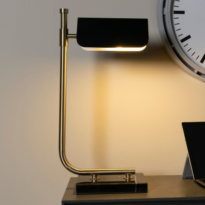 Carmen Table Lamp in Gold and Black 51cm light lifestyle image